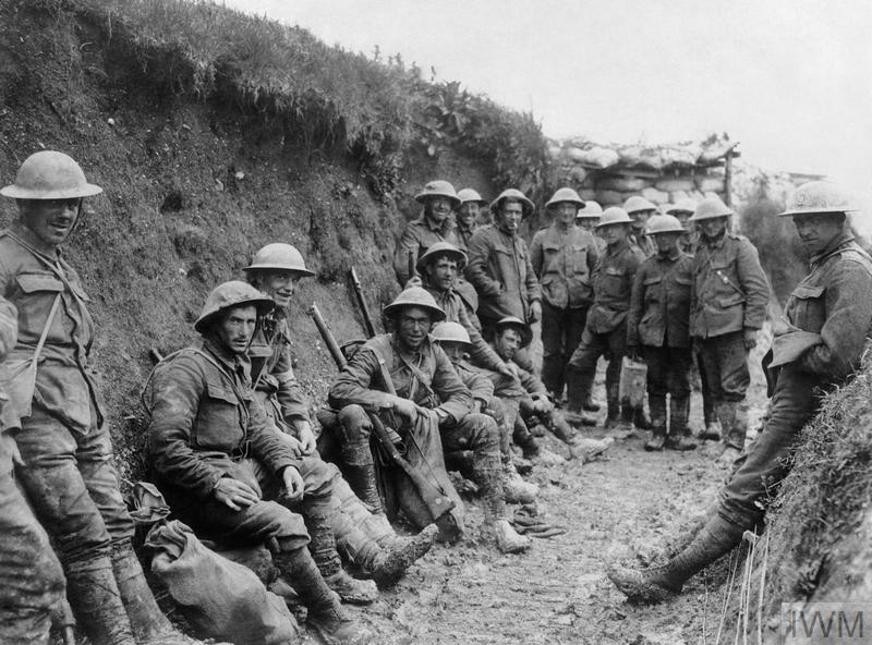 THE BATTLE OF THE SOMME, JULY-NOVEMBER 1916 (Q 1) Troops of the Royal Irish Rifles resting in a communication trench during the opening hours of the Battle of the Somme, 1 July 1916. Copyright: © IWM. Original Source: http://www.iwm.org.uk/collections/item/object/205193964